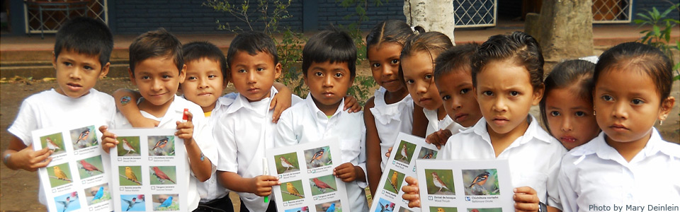 Image of children holding bird migration pictures